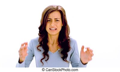Brunette shaking head and pulling at hair with anger on...