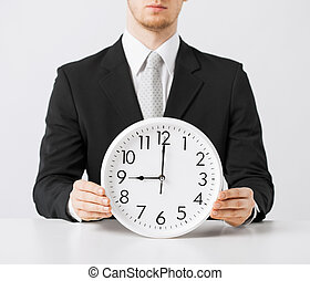 man with wall clock - close up of man holding wall clock
