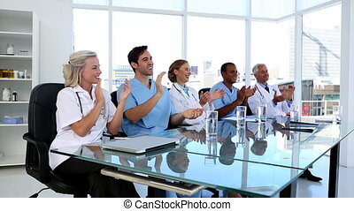 Medical team applauding during conference