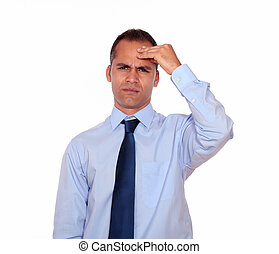 Adult man with headache holding his forehead