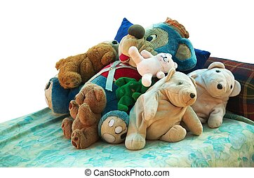 Old stuffed animals on a bed - Old stuffed animals lying on...