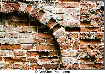 old brick wall with arch
