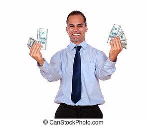 Smiling latin adult man holding cash dollars