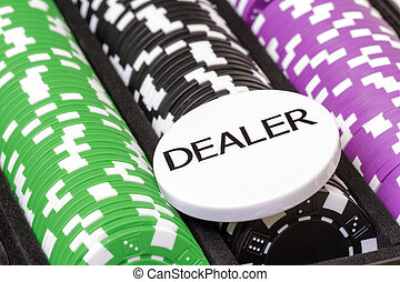 Set of poker chips and dealer button