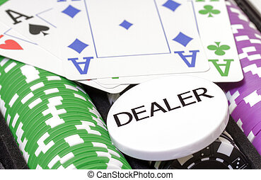 Set of poker chips, cards and dealer button closeup