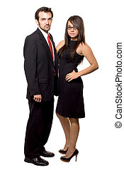 Business couple - Full body of an attractive brunette woman...