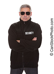 Mature security man standing over white background