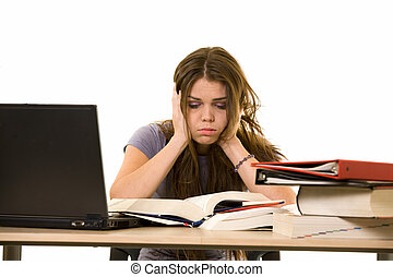 Frustrated college student - Young woman sitting at desk in...