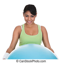 Young Woman Exercising With Pilates Ball Over White...