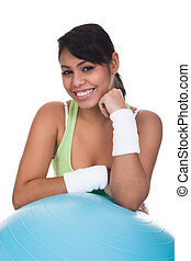 Woman Leaning On Pilates Ball - Young Woman Leaning On...