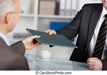 Job interview - Portrait of a manager giving folder to a...