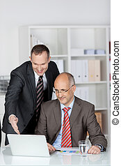 Two smiling cheerful businesspeople