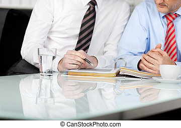 Detail Of Casual Businessman - Casual Businessman consulting...