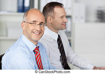 Two businessmen inside the office - Portrait of two...