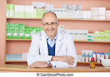 Handsome pharmacist in drugstore