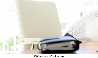 Businesswoman taking a nap leaning on her desk