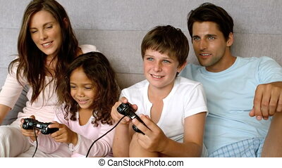 Family playing at video game in slow motion at 500 frames...