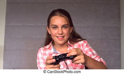 Girl playing at video game in slow motion at 500 frames per...