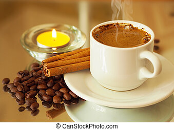 romantic background with a candle and a cup of coffee