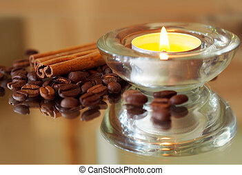 romantic background with candles, coffee beans and cinnamon