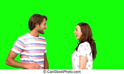 Friends giving high-five on green screen in slow motion