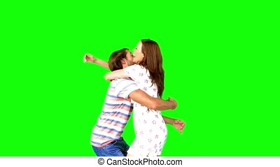 Couple meeting again on green screen in slow motion