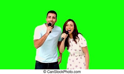 Friends dancing and singing on green screen in slow motion