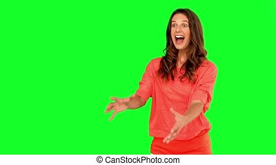 Cheerful woman catching a basketball on green screen in slow...