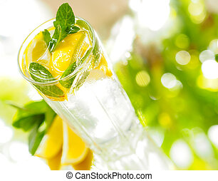 a glass of mineral water with lemon