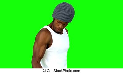 Young man using dumbbell in slow motion on green screen