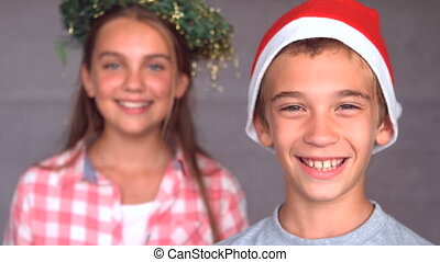 Smiling siblings with christmas hat in slow motion at 250...