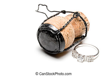 Wedding Ring - A wedding ring next to a champagne cork.