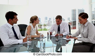 Business people having a serious discussion during a meeting