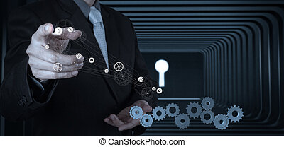 Businessman hand with  key to success as concept