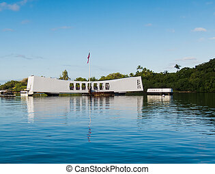 Pearl Harbor Memorial with flag reflected in the water