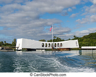 Pearl Harbor Memorial with flag and boat wake