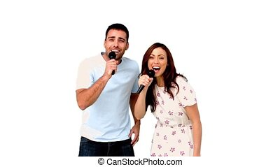 Friends dancing and singing on white background in slow...