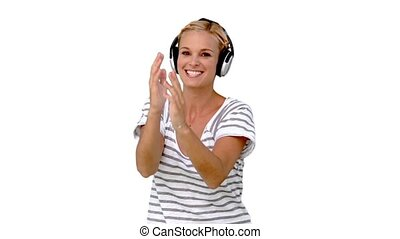 Young woman listening to music on w