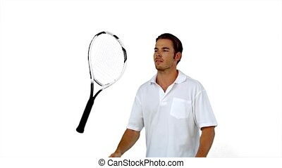 Tennis player throwing his racket in slow motion on white...
