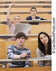 Participating students in a lecture hall - Four students...