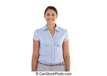 Smiling businesswoman standing alone on white background
