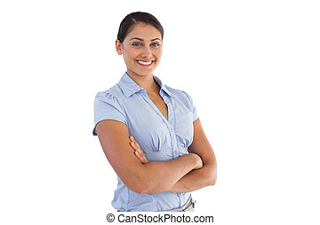 Smiling businesswoman crossing her arms
