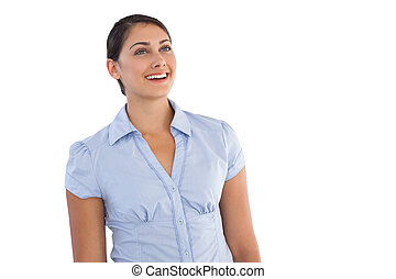 Smiling young businesswoman standing alone on white...