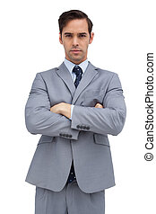 Young businessman looking at camera