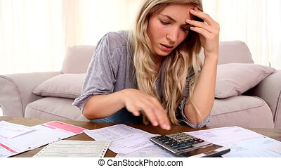 Blonde woman stressing over account