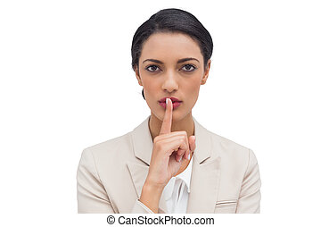 Businesswoman asking for silence on white background