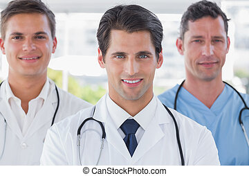 Smiling medical team standing