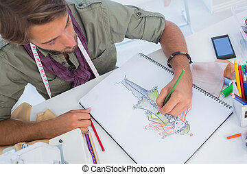 Fashion designer creating a coat for woman with pencils
