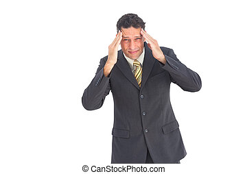Anxious businessman with hands on his head wearing a suit
