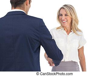 Business people shaking hands on a white background